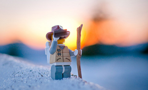 photo of a lego guy looking into the horizon with the sun setting, represents the importance of SEO